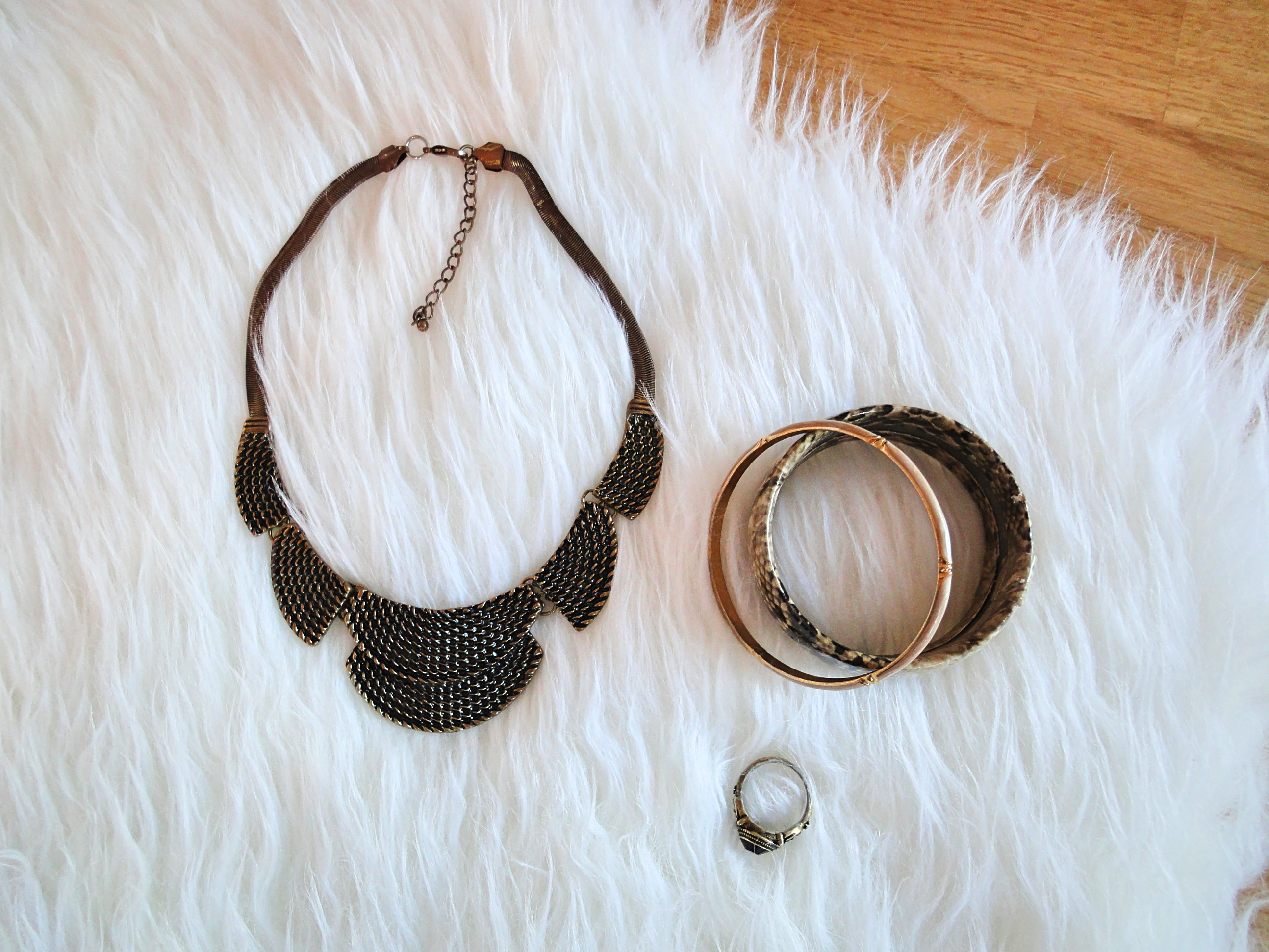 Necklace, bangle and ring in simple tone